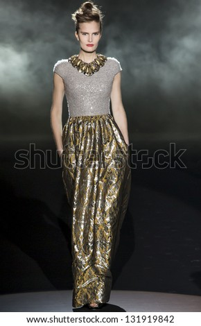 NEW YORK - FEBRUARY 12: A model is walking the runaway at Badgley Mischka Show for Fall/Winter 2013 Collection during Mercedes-Benz Fashion Week on February 12, 2013 in New York - stock photo
