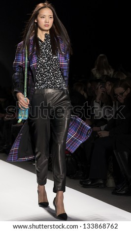 NEW YORK - FEBRUARY 8: A model is walking the runaway at Rebecca Minkoff Show for Fall/Winter 2013 Collection during Mercedes-Benz Fashion Week on February 8, 2013 in New York - stock photo