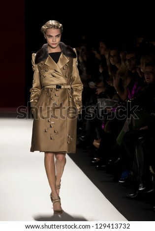 NEW YORK - FEBRUARY 11: A model is walking the runway at Carolina Herrera Collection for Fall/Winter 2013 during Mercedes-Benz Fashion Week on February 11, 2013 in New York