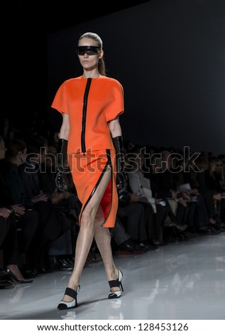 NEW YORK - FEBRUARY 13: A model is walking the runway at Michael Kors Collection for Fall/Winter 2013 during Mercedes-Benz Fashion Week on February 13, 2013 in New York