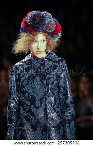 NEW YORK - FEBRUARY 12: A model walks the runway at the Desigual Fall/Winter 2015 collection during Mercedes-Benz Fashion Week in New York on February 12, 2015.