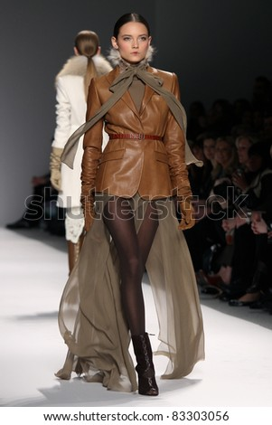 NEW YORK - FEBRUARY 16: A model walks the runway at the Elie Tahari Fall 2011 Collection Presentation during Mercedes-Benz Fashion Week on February 16, 2011 in New York.