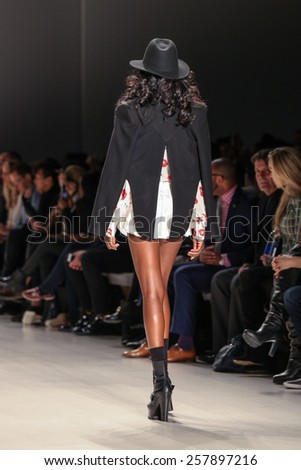 NEW YORK - FEBRUARY 13: A model walks the runway at the Mark & Estel Fall/Winter 2015 collection during Mercedes-Benz Fashion Week in New York on February 13, 2015. - stock photo