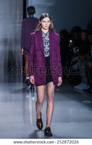 NEW YORK - FEBRUARY 14: A model walks the runway at the Noon by Noor Fall/Winter 2015 collection during Mercedes-Benz Fashion Week in New York on February 14, 2015. - stock photo
