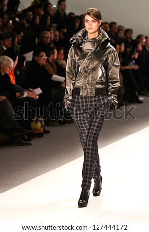 NEW YORK - FEBRUARY 07:A model walks the runway at the Richard Chai Love and Richard Chai Men`s Fall 2013 collection Mercedes-Benz Fashion Week in New York on February 07, 2013