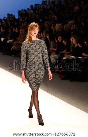 NEW YORK - FEBRUARY 07:A model walks the runway at the  Tadashi Shoji  Fall 2013 collection Mercedes-Benz Fashion Week in New York on February 07,2013