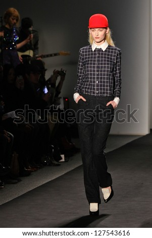 NEW YORK - FEBRUARY 07:A model walks the runway at the Timo Weiland Women`s  Fall 2013 collection Mercedes-Benz Fashion Week in New York on February 07,2013