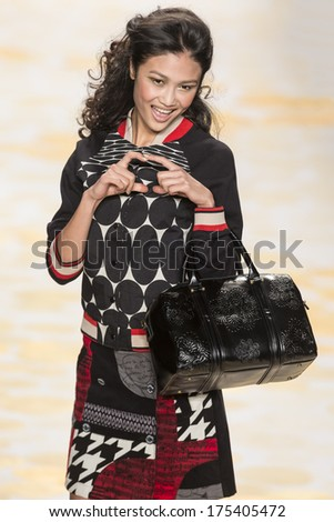 NEW YORK - FEBRUARY 06 2014: A model walks the runway during the Desigual fall 2014 fashion show at New York Mercedes - Benz Fashion Week - stock photo