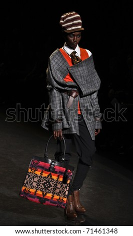 NEW YORK - FEBRUARY 17: A model walks the runway for L.A.M.B. collection by Gwen Stefani at Mercedes-Benz Fall/Winter 2011 Fashion Week on February 17, 2011 in New York City.