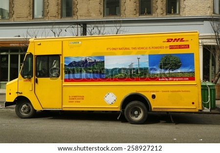 NEW YORK - FEBRUARY 26, 2015: DHL van in Lower Manhattan. DHL is a world wide courier company that operates in 220 countries with over 285,000 employees