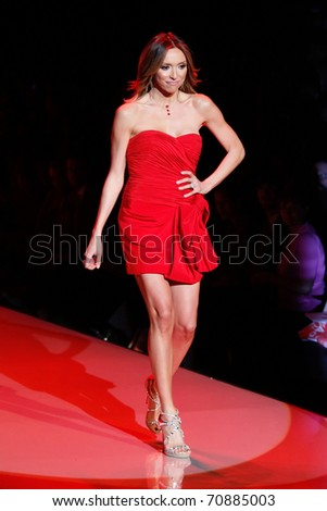 NEW YORK - FEBRUARY 9:  Giuliana Rancic walks the runway at The Heart Truth's Red Dress Fashion Show during Mercedes-Benz Fashion Week at Lincoln Center on February 9, 2011 in New York City.