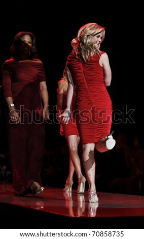 NEW YORK - FEBRUARY 09: Ladies walk runway for The Heart Truth's Red Dress Collection at Mercedes-Benz Fall/Winter 2011 Fashion Week on February 09, 2011 in New York City.