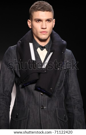 NEW YORK - FEBRUARY 12: Male model walks the runway at the G-STAR RAW Fall 2011 Collection presentation during Mercedes-Benz Fashion Week on February 12, 2011 in New York.