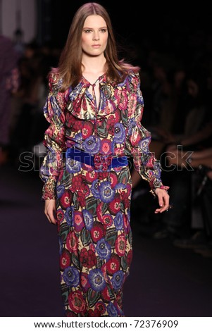 NEW YORK - FEBRUARY 16: Model Caroline Brasch Nielsen  walks the runway at the Anna Sui Fall 2011 Collection presentation during Mercedes-Benz Fashion Week on February 16, 2011 in New York. - stock photo