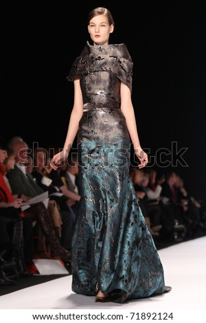 NEW YORK - FEBRUARY 14: Model Kirsi Pyrhonen walks the runway at the Carolina Herrera Fall 2011 Collection presentation during Mercedes-Benz Fashion Week on February 14, 2011 in New York. - stock photo