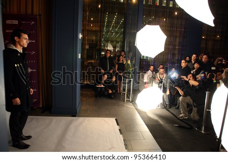 NEW YORK - FEBRUARY 13: Model poses for photographers at the Sergio Davila Fall/Winter 2012 collection presentation at Lounge 48 during New York Fashion Week on February 13, 2012 in New York City. - stock photo