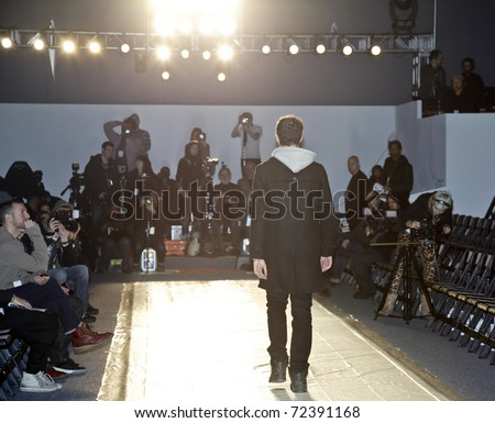 NEW YORK - FEBRUARY 10: Model rehearses for Duckie Brown collection by Steven Cox, Daniel Silver Mercedes-Benz Fall/Winter 2011 Fashion Week on February 10, 2011 in New York City - stock photo