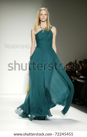 NEW YORK - FEBRUARY 10: Model Theres Alexandersson walks the runway at the Tadashi Shoji Fall 2011 Collection presentation during Mercedes-Benz Fashion Week on February 14, 2011 in New York. - stock photo
