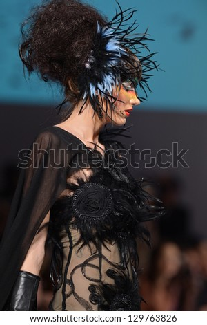 NEW YORK - FEBRUARY 15: Model walking the runway at Catalin Botezatu fashion show at The New Yorker Hotel during Couture Fashion Week on February 15, 2013 in New York City - stock photo