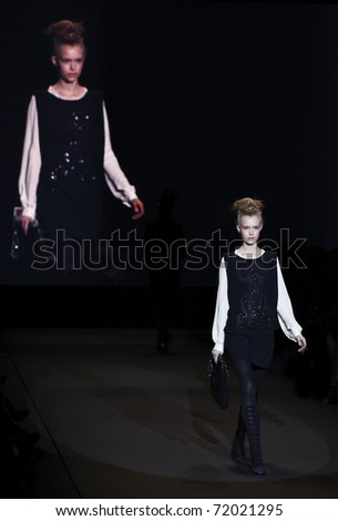 NEW YORK - FEBRUARY 12: Model walks runway for collection by Vivienne Tam at Mercedes-Benz Fall/Winter 2011 Fashion Week on February 12, 2011 in New York City