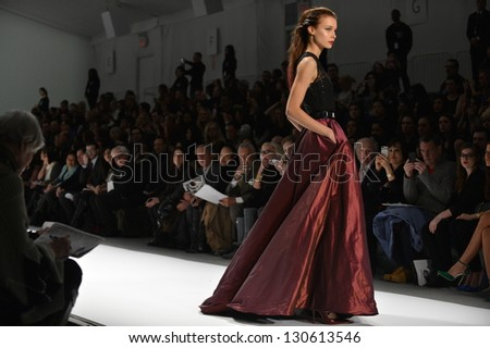 NEW YORK - FEBRUARY 08: Model walks the runway at the Carmen Marc Valvo fall 2013 fashion show during Mercedes-Benz Fashion Week on February 8, 2013 in New York City. - stock photo