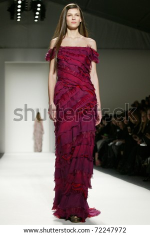 NEW YORK - FEBRUARY 10: Model walks the runway at the Tadashi Shoji Fall 2011 Collection presentation during Mercedes-Benz Fashion Week on February 10, 2011 in New York.