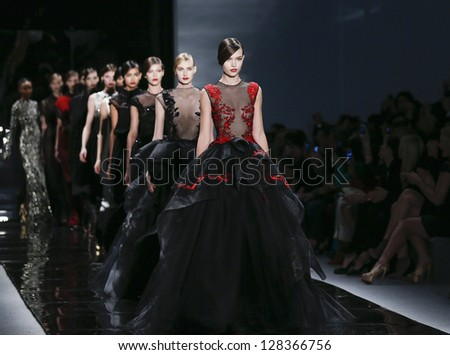 NEW YORK - FEBRUARY 11: Models walk runway during Fall/Winter 2013 presentation for Reem Acra collection at Mercedes-Benz Fashion Week at Lincoln Center on February 11, 2013 in New York - stock photo