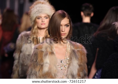 NEW YORK - FEBRUARY 16: Models walk the runway at the Anna Sui Fall 2011 Collection during Mercedes-Benz Fashion Week on February 16, 2011 in New York. - stock photo
