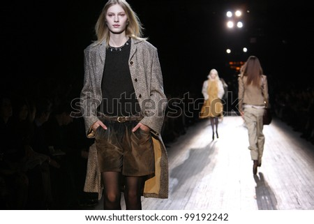 NEW YORK - FEBRUARY 13: Models walk the runway at the Theyskens' Theory FW 2012 collection presentation during Mercedes-Benz Fashion Week on February 13, 2012 in New York.
