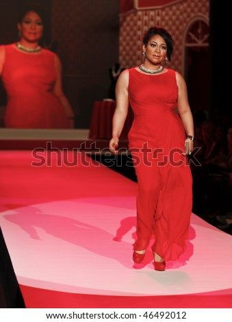 NEW YORK - FEBRUARY 11: Raven-Symone walks the runway [dress by Tadashi Shoji ] at the Heart Truth's Red Dress Collection for Fall 2010 during Mercedes-Benz Fashion Week on February 11, 2010 in New York