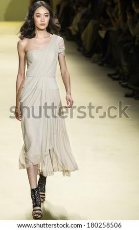 NEW YORK - FEBRUARY 13 2014: Shu Pei Qin walks the runway during the J Mendel Fall 2014 fashion show at New York Mercedes - Benz Fashion Week - stock photo