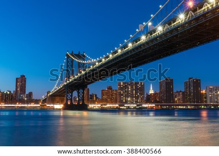 NEW YORK - FEBRUARY, 20: The Manhattan Bridge at night across the East River from Brooklyn.