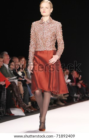 NEW YORK - FEBRUARY 14: Top model Hanne Gaby Odiele walks the runway at the Carolina Herrera Fall 2011 Collection presentation during Mercedes-Benz Fashion Week on February 14, 2011 in New York.