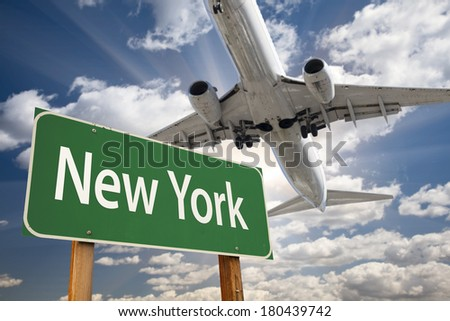 New York Green Road Sign and Airplane Above with Dramatic Blue Sky and Clouds. - stock photo