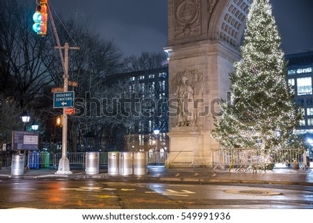 NEW YORK - JAN 3, 2017: beautiful silent night on Washington Square Park North, green traffic light and Christmas tree, arch in NYC. WSP is one of 1,900 public parks, and is located in the Village.