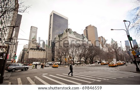 NEW YORK - JAN 6: City streetlife in point of intersection of 5th Av. and 60th st. near  Central Park on January 6, 2011 in Manhattan, New York City - stock photo