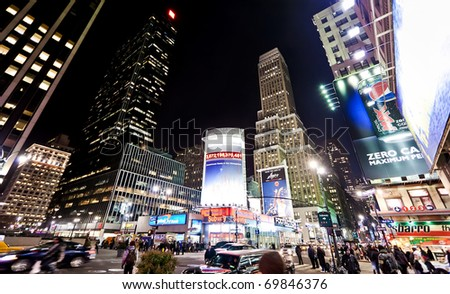 NEW YORK - JAN 6: Night streetscene in point of intersection of 7th Av. and 34th st. near Madison Square Gardenl on January 6, 2011 in Manhattan, New York City - stock photo
