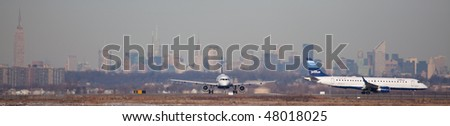 NEW YORK - JANUARY 6: A Airbus A320 plane  , Jet Blue departs from JFK Airport Runway 4L January 6, 2010 in New York - stock photo