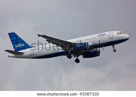 NEW YORK - JANUARY 11: A320 JetBlue on final approach to JFK in New York, USA on January 11, 2012. JetBlue is New York based, fastest growing airline in the world. They use Airbuses and Embraers - stock photo