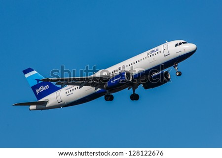 NEW YORK - JANUARY 9: Airbus A320 JetBlue climb after take off from JFK in New York USA on January 9, 2013 The A320, the first narrow body airliner, is the biggest competition to Boeing 737NG - stock photo