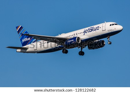 NEW YORK - JANUARY 9: Airbus A320 JetBlue climbs after take off from JFK in New York USA on January 9, 2012 The A320 the first narrow body airliner is the biggest competition to Boeing 737NG - stock photo
