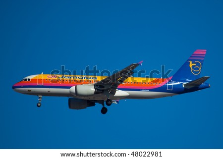 NEW YORK - JANUARY 9: An Airbus A320 Jamaica Air  lands at JFK Airport on Runaway 31R on January 9, 2010 in New York. - stock photo