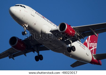 NEW YORK - JANUARY 9: An Airbus A319 Virgin  lands at JFK Airport on Runaway 31R on January 9, 2010 in New York. - stock photo