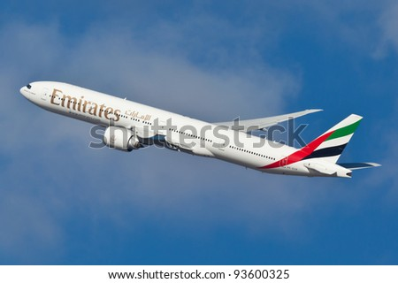 NEW YORK - JANUARY 10: Boeing 777 Emirates climbs after take off from JFK airport located in New York January 10, 2012 Emirates is rated as a top10 best airline in the world flying on youngest fleet - stock photo