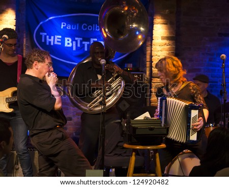 NEW YORK - JANUARY 12: Hazmat Modine band performs on stage as part of NYC Winter Jazz Festival at The Bitter End on January 12, 2013 in New York City - stock photo