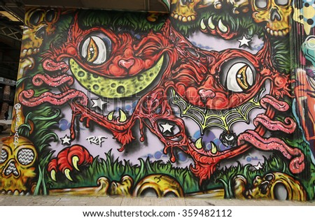 NEW YORK - JANUARY 7, 2016: Mural art at East Williamsburg in Brooklyn. Outdoor art gallery known as the Bushwick Collective has most diverse collection of street art in Brooklyn
