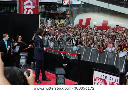 NEW YORK-JUL 27: Actor Tom Cruise waves to the crowd at the US Premiere of 'Mission: Impossible - Rogue Nation' in Times Square on July 27, 2015 in New York City. - stock photo