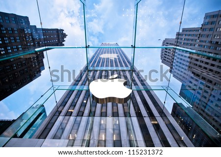 NEW YORK - JULY 21: Apple store on Fifth Avenue on July 21 2012 in New York City, USA. The store in it self is all underground except for the 32-foot glass cube right in front of f the GM building - stock photo