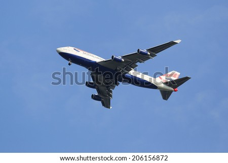 NEW YORK - JULY 20: British Airways Boeing 747-400 in New York sky before landing at JFK Airport on July 20, 2014 - stock photo
