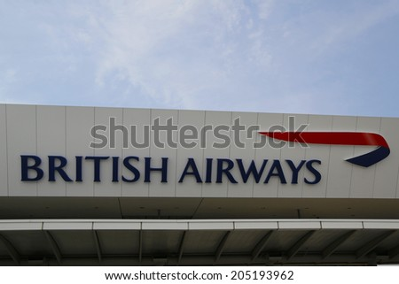 NEW YORK- JULY 10: British Airways Terminal 7 at John F Kennedy International Airport in New York on July 10, 2014. JFK is one of the biggest  airports in the world with 4 runways and 8 terminals  - stock photo